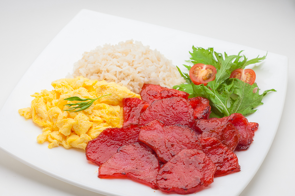 breakfast meal of tocino, egg, salad and rice