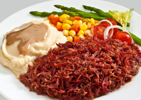 corned beef with mashed potato and salad
