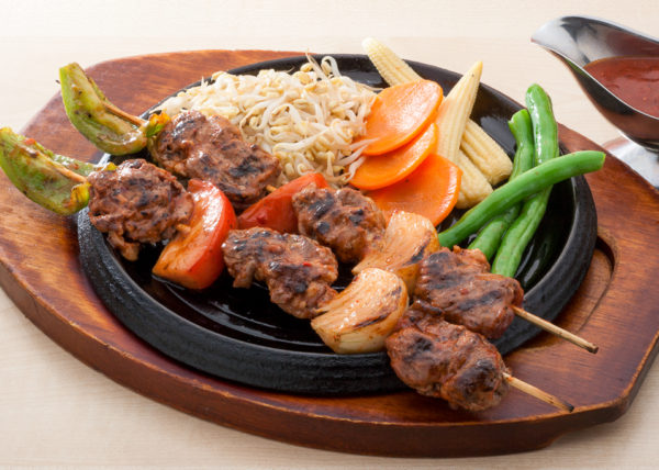 barbecue and vegetables in hotplate