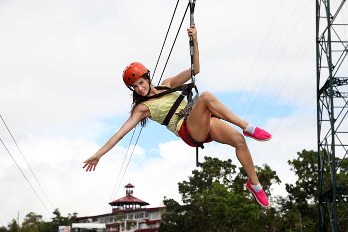 a lady on a zip line