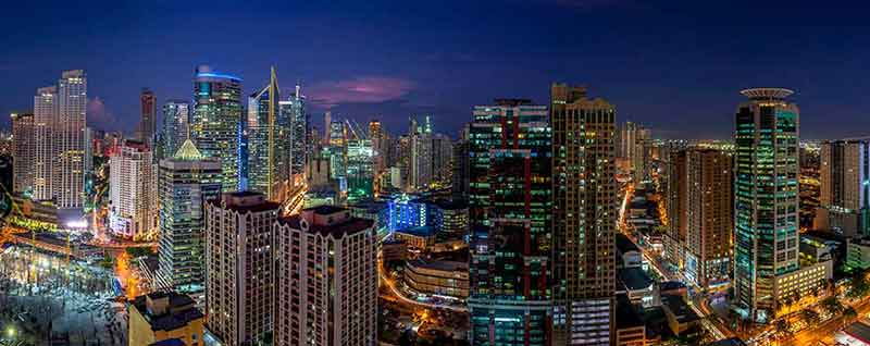 Panoramic view of Makati skyline at dusk
